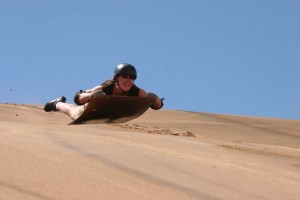 sand surfing, backpacking namibia, bucket list ideas